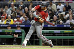 Arizona Diamondbacks' David Peralta drives in two runs with a double off Pittsburgh Pirates relief pitcher Nick Kingham during the seventh inning of a baseball game in Pittsburgh, Wednesday, April 24, 2019. (AP Photo/Gene J. Puskar)