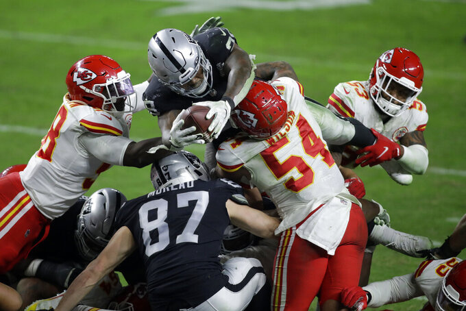 Las Vegas Raiders running back Josh Jacobs (28) dives into the air for an unsuccessful attempt at a touchdown against the Kansas City Chiefs during the second half of an NFL football game, Sunday, Nov. 22, 2020, in Las Vegas. (AP Photo/Isaac Brekken)