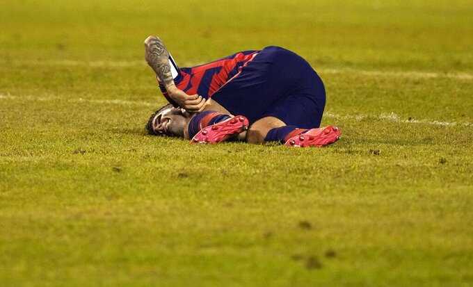United States' Christian Pulisic grimaces after being fouled during a qualifying soccer match for the FIFA World Cup Qatar 2022, against Honduras in San Pedro Sula, Honduras, Wednesday, Sept. 8, 2021. (AP Photo/Moises Castillo)