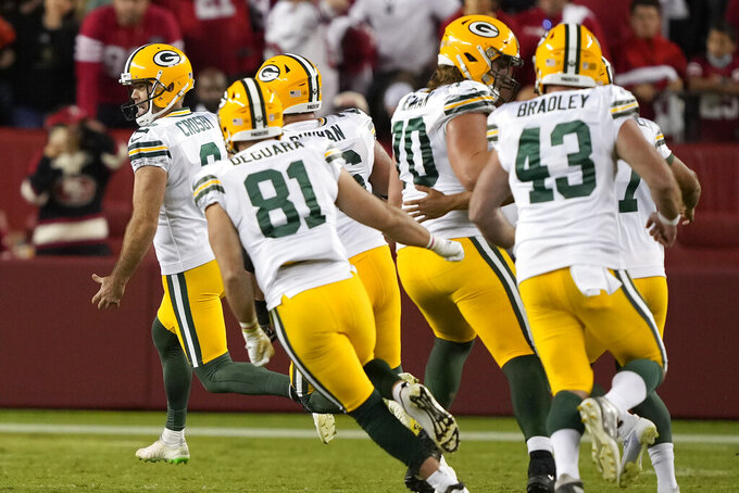 Green Bay Packers kicker Mason Crosby, left celebrates with teammates after kicking the game winning field goal against the San Francisco 49ers during the second half of an NFL football game in Santa Clara, Calif., Sunday, Sept. 26, 2021. (AP Photo/Tony Avelar)