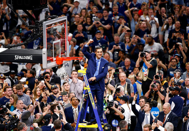 FILE - In this April 2, 2018, file photo, Villanova head coach Jay Wright reacts after cutting down the net after beating Michigan 79-62 in the championship game of the Final Four NCAA college basketball tournament, in San Antonio. (AP Photo/Brynn Anderson, File)