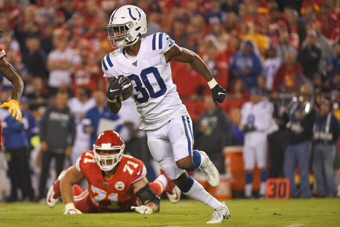 FILE - Indianapolis Colts safety George Odum (30) carries the ball away from Kansas City Chiefs offensive tackle Mitchell Schwartz (71) during the first half of an NFL football game against the Kansas City Chiefs in Kansas City, Mo., in this Sunday, Oct. 6, 2019, file photo. Odum was selected Friday, Jan. 8, 2021, to The Associated Press All-Pro Team. (AP Photo/Reed Hoffmann, FIle)