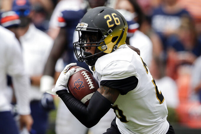 Alabama State defensive back Trevor Robinson (26) carries the ball on a kick return against Auburn during the second half of an NCAA football game Saturday, Sept. 11, 2021, in Auburn, Ala. (AP Photo/Butch Dill)