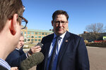 Kansas House Speaker Ron Ryckman Jr., R-Olathe, discusses a U.S. Department of Homeland Security briefing with reporters outside the Statehouse, Tuesday, Jan. 14, 2020, in Topeka, Kan. The Kansas attorney general's office said the briefing had to be closed to reporters, staffers and the general public because it dealt with security concerns. (AP Photo/John Hanna)