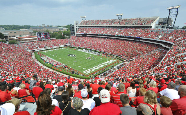 FILE - In this Sept. 5, 2015, file photo, Georgia fans watch the season opening NCAA college football game against Louisiana Monroe at Sanford Stadium n Athens, Ga. The Georgia Bulldog are planning to have fans between the hedges. The school announced ticket plans that call for allowing 20-25% capacity at 92,746-seat Sanford Stadium.  (AP Photo/John Amis, File)