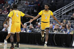 Valparaiso's Javon Freeman-Liberty (0) is congratulated by teammate Daniel Sackey (4) after making a basket during the second half of an NCAA college basketball game against Missouri State in the semifinal round of the Missouri Valley Conference men's tournament Saturday, March 7, 2020, in St. Louis. (AP Photo/Jeff Roberson)