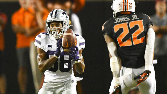 Kansas State Phillip Brooks (88) catches a kick under the watchful eye of Oklahoma State cornerback Demarco Jones (22) during an NCAA college football game Saturday, Sept. 25, 2021, in Stillwater, Okla. (AP Photo/Brody Schmidt)