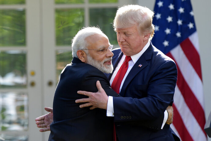 FILE - In this June 26, 2017, file photo, President Donald Trump and Indian Prime Minister Narendra Modi hug while making statements in the Rose Garden of the White House in Washington. Officials in the U.S. and Indian governments say President Donald Trump is in the early stages of planning what would be his first visit to India, the world's largest democracy. (AP Photo/Susan Walsh, File)