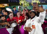Kansas City Chiefs' Derrick Nnadi poses with fans during Opening Night for the NFL Super Bowl 54 football game Monday, Jan. 27, 2020, at Marlins Park in Miami. (AP Photo/David J. Phillip)