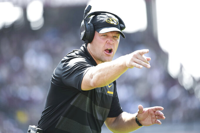 Missouri head coach Barry Odom communicates with an official during the first half of an NCAA college football game against South Carolina, Saturday, Oct. 6, 2018, in Columbia, S.C. (AP Photo/Sean Rayford)