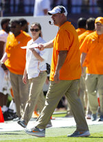 Tennessee head coach Jeremy Pruitt yells at this sideline during the first half of an NCAA college football game against Auburn, Saturday, Oct. 13, 2018, in Auburn, Ala. (AP Photo/Vasha Hunt)