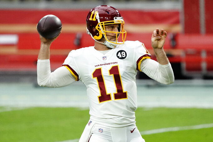 Washington Football Team quarterback Alex Smith (11) warms up prior to an NFL football game against San Francisco 49ers, Sunday, Dec. 13, 2020, in Glendale, Ariz. (AP Photo/Rick Scuteri)
