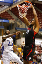 Northeastern's Anthony Green (30) dunks the ball against Hofstra's Jacquil Taylor (23) in the first half of an NCAA college basketball game at the Colonial Athletic Association men's basketball championship, Tuesday, March 12, 2019, in North Charleston, S.C. (AP Photo/Mic Smith)
