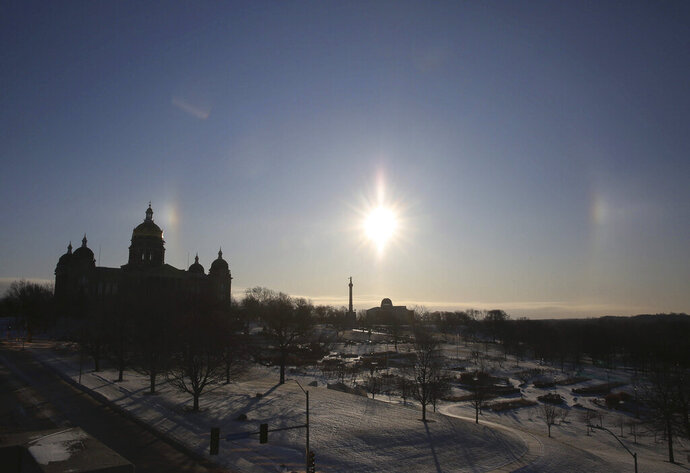 A sun dog forms over the Iowa State Capitol grounds in Des Moines, Iowa, on Thursday, Feb. 13, 2020. Temperatures plummeted below zero overnight with a windchill of -30. (Bryon Houlgrave/The Des Moines Register via AP)