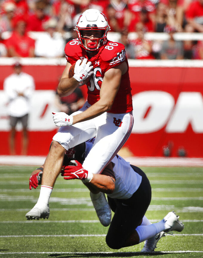 Utah tight end Branden Anderson (88) is tackled by Washington State defensive end Ron Stone Jr. (B) in the second half, of an NCAA college football game Saturday, Sept. 25, 2021, in Salt Lake City. (AP Photo/George Frey)