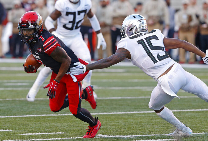 Utah wide receiver Demari Simpkins (7) eludes Oregon cornerback Deommodore Lenoir (15) in the first half during an NCAA college football game Saturday Nov. 10, 2018, in Salt Lake City. (AP Photo/Rick Bowmer)