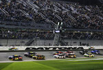 Pole-sitter William Byron (24) leads Jimmie Johnson (48), Daniel Hemric (8) and the rest of the field to start the first of two qualifying auto races for the NASCAR Daytona 500 at Daytona International Speedway, Thursday, Feb. 14, 2019, in Daytona Beach, Fla. (AP Photo/Terry Renna)