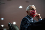 Director of the National Institute of Allergy and Infectious Diseases Dr. Anthony Fauci wears a face covering as he listens during a Senate Health, Education, Labor and Pensions Committee hearing on Capitol Hill in Washington, Tuesday, June 30, 2020. (Al Drago/Pool via AP)