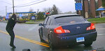 This still image from police dash camera video released Friday, May 3, 2019, by the Hartford State's Attorney shows Police Officer Layau Eulizier, Jr., pointing his weapon at a car being driven at him by Anthony Jose Vega Cruz during an attempted traffic stop April 20 in Wethersfield, Conn. Eulizier shot through the windshield, striking Vega Cruz, of Wethersfield, who died two days later at a hospital. (Hartford State's Attorney via AP)