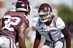 FILE - In this Aug. 18, 2020, file photo provided by Mississippi State Athletics, Mississippi State cornerback Martin Emerson (1) sets up for a passing drill during the practice for the NCAA college football team in Starkville, Miss. What remains of a college football season already altered by the pandemic is about to ramp up this weekend. Outbreaks can leave teams unable to play, not just because they sideline the infected but also because anyone deemed a close or high-risk contact is required to quarantine for 14 days. (Austin Perryman/Mississippi State Athletics via AP, File)