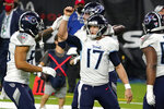 Tennessee Titans quarterback Ryan Tannehill (17) celebrates with MyCole Pruitt (85) after running for a touchdown against the Houston Texans during the second half of an NFL football game Sunday, Jan. 3, 2021, in Houston. (AP Photo/Eric Christian Smith)