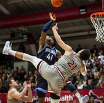 Villanova forward Saddiq Bey (41) is fouled by Saint Joseph's forward Lorenzo Edwards (21) during the second half of an NCAA college basketball game, Saturday, Dec. 7, 2019, in Philadelphia. Villanova won 78-66. (AP Photo/Laurence Kesterson)