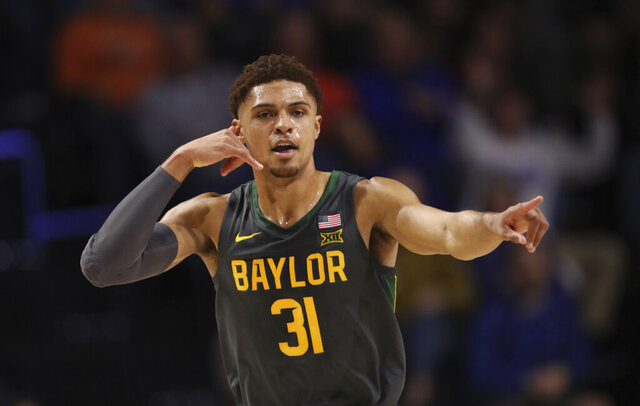 Baylor guard MaCio Teague (31) celebrates after making a basket against the Florida during the first half of an NCAA college basketball game Saturday, Jan. 25, 2020, in Gainesville, Fla. (AP Photo/Matt Stamey)