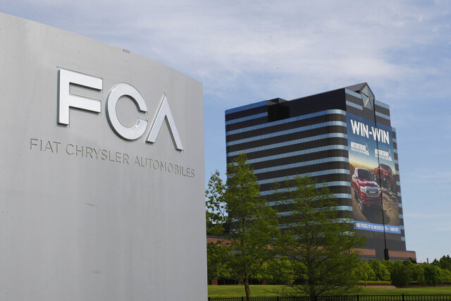 "FILE - This May 27, 2019, file photo shows the Fiat Chrysler Automobiles world headquarters in Auburn Hills, Mich.Fiat Chrysler Automobiles is denying allegations by General Motors that FCA used foreign bank accounts to bribe union officials so they would stick GM with higher labor costs. In court papers filed Monday, Aug. 10, 2020, the Italian-American automaker said GM was using court records to make ""defamatory and baseless"