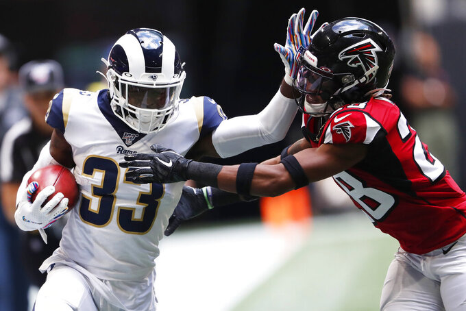 Los Angeles Rams defensive back Nick Scott (33) hits Atlanta Falcons defensive back Jordan Miller (28) during the first half of an NFL football game, Sunday, Oct. 20, 2019, in Atlanta. (AP Photo/John Bazemore)