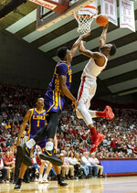 Alabama forward Donta Hall (0) dunks a rebound over LSU forward Kavell Bigby-Williams (11) during the second half of an NCAA college basketball game, Saturday, March 2, 2019, in Tuscaloosa, Ala. (AP Photo/Vasha Hunt)