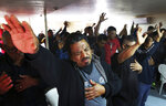 """Evangelicals hold up their hands in prayer for their neighbor Christina Langford Johnson a victim of a cartel ambush that killed nine American women and children earlier this week, at the """"Fuente de Vida"""" church in Colonia LeBaron, Mexico, Saturday, Nov. 9, 2019. In the attack Monday, Langford Johnson jumped out of her vehicle and waved her hands to show she was no threat to the attackers and was shot twice in the heart, community members say. Her daughter Faith Marie Johnson, 7 months old, was found unharmed in her car seat. (AP Photo/Marco Ugarte)"""