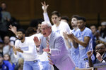 FILE - In this March 7, 2020, file photo, North Carolina coach Roy Williams applauds during the second half of the team's NCAA college basketball game against Duke in Durham, N.C. The Tar Heels are coming off the first losing season in Williams' career. (AP Photo/Gerry Broome, File)
