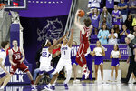 Oklahoma guard Austin Reaves (12) goes up for a shot in the final seconds of the second half as TCU guard RJ Nembhard (22) and guard Desmond Bane (1) defend in an NCAA college basketball game in Fort Worth, Texas, Saturday, March 7, 2020. The bucket gave Oklahoma the lead and the 78-76 win. (AP Photo/Tony Gutierrez)