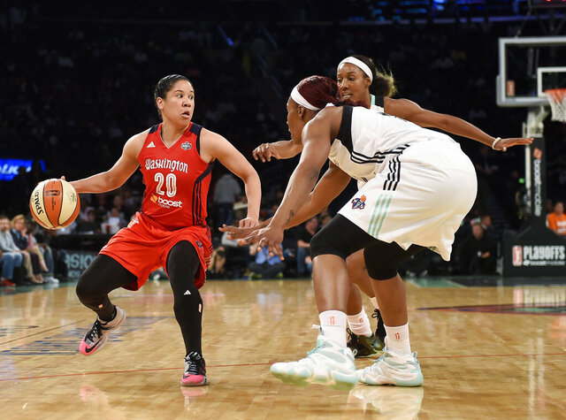 FILE - In this Sept. 22, 2015, file photo, Washington Mystics guard Kara Lawson (20) tries to move around the defense of New York Liberty center Avery Warley-Talbert, front right, and guard Candice Wiggins during the first half of Game 3 of a WNBA basketball Eastern Conference semifinal series in New York. Lawson has always wanted to coach at Duke, a fact the first-time college coach had not shared with many people. Once the job opened up earlier this month, the Boston Celtics assistant jumped at the opportunity. (AP Photo/Kathy Kmonicek, File)
