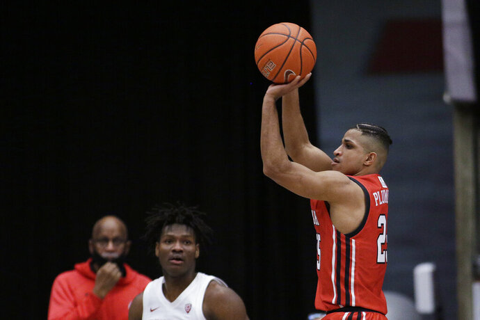 Utah guard Alfonso Plummer shoots next to Washington State center Efe Abogidi during the second half of an NCAA college basketball game in Pullman, Wash., Thursday, Jan. 21, 2021. (AP Photo/Young Kwak)