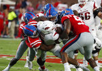 Mississippi defense tackles Arkansas running back Rakeem Boyd (5) is tackled behind the line of scrimmage during the first half of their NCAA college football game, Saturday, Sept. 7, 2019, in Oxford, Miss. (AP Photo/Rogelio V. Solis)