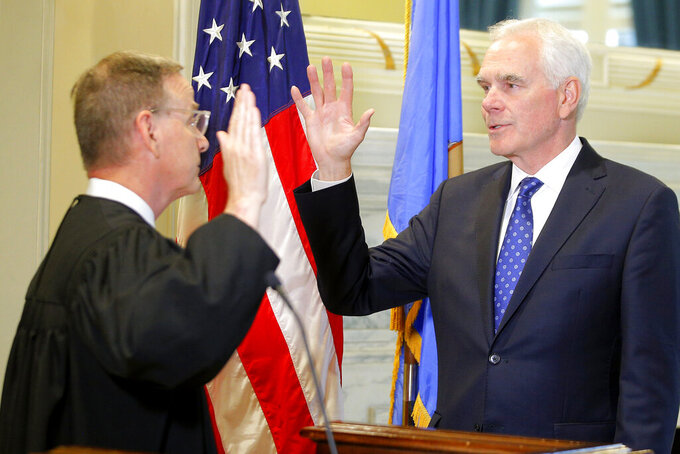 John O'Connor, right, is sworn in as Oklahoma's new attorney general by Oklahoma Supreme Court Justice M. John Kane IV at the state Capitol in Oklahoma City, Friday, July 23, 2021. Gov. Kevin Stitt named 66-year-old O'Connor to the post on Friday after a two-month search. (Bryan Terry/The Oklahoman via AP)