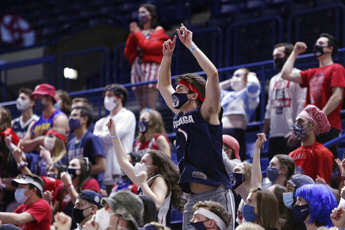 Gonzaga fans react while watching the NCAA Final Four college championship basketball game between Gonzaga and Baylor during a watch party at the McCarthey Athletic Center in Spokane, Wash., Monday, April 5, 2021. (AP Photo/Young Kwak)