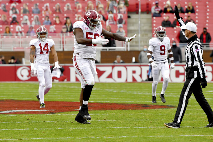 Alabama defensive lineman Christian Barmore (58) reacts after a sack against Arkansas during the first half an NCAA college football game Saturday, Dec. 12, 2020, in Fayetteville, Ark. (AP Photo/Michael Woods)