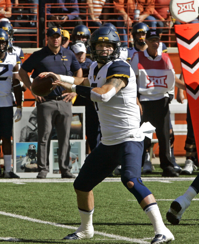West Virginia quarterback Will Grier looks to pass during the first half of an NCAA college football game against Texas, Saturday, Nov. 3, 2018, in Austin, Texas. (AP Photo/Michael Thomas)
