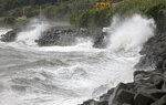 High waves pound the coast of the Kagoshima city in the southwestern island of Kyushu, Japan. The second powerful typhoon to slam Japan in a week unleashed fierce winds and rain on southern islands on Sunday, blowing off rooftops and leaving homes without power as it edged northward into an area vulnerable to flooding and mudslides. (Kyodo News via AP)