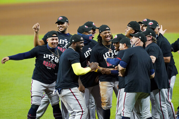Atlanta Braves players celebrate after defeating the Miami Marlins in Game 3 of a baseball National League Division Series, Thursday, Oct. 8, 2020, in Houston. (AP Photo/David J. Phillip)