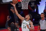 Milwaukee Bucks' Giannis Antetokounmpo tries to shoot past Miami Heat's Jae Crowder during the first half of an NBA conference semifinal playoff basketball game Sunday, Sept. 6, 2020, in Lake Buena Vista, Fla. (AP Photo/Mark J. Terrill)