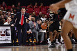 Bryant University head coach Jared Grasso directs his team during the first half of an NCAA college basketball game against Maryland, Sunday, Dec. 29, 2019, in College Park, Md. (AP Photo/Brien Aho)