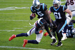 Carolina Panthers quarterback Teddy Bridgewater scores past Denver Broncos safety Justin Simmons during the second half of an NFL football game Sunday, Dec. 13, 2020, in Charlotte, N.C. (AP Photo/Gerry Broome)