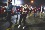 Alabama fans celebrate in the street in Tuscaloosa, Ala., Monday night, Jan. 11, 2021, after Alabama defeated Ohio State 52-24 in the NCAA college football national championship game in Miami Gardens, Fla.  (Benjamin Flanagan/Alabama Media Group via AP)