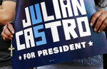 A supporter for 2020 Democratic presidential candidate Julian Castro holds a sign supporting Castro during a rally in San Antonio, Wednesday, April 10, 2019. (AP Photo/Eric Gay)