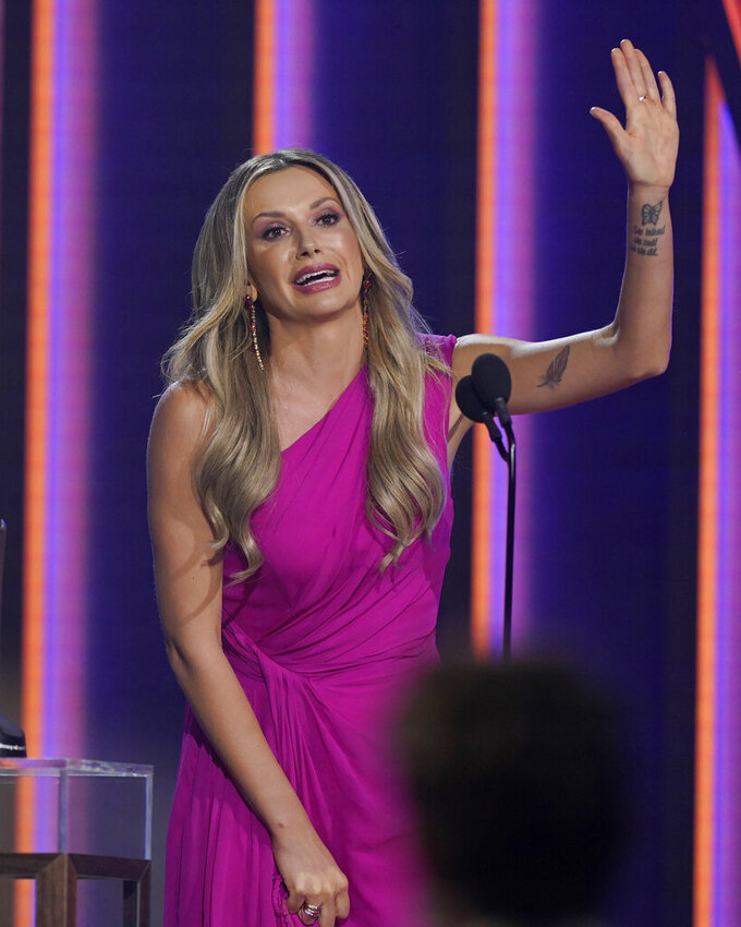 """Carly Pearce accepts the award for single of the year for """"I Hope You're Happy Now"""" at the 56th annual Academy of Country Music Awards on Sunday, April 18, 2021, at the Grand Ole Opry in Nashville, Tenn. (AP Photo/Mark Humphrey)"""