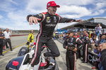 Josef Newgarden (2) jumps from his car to celebrate with his team after winning the championship after an IndyCar auto race at Laguna Seca Raceway in Monterey, Calif., Sunday, Sept. 22, 2019. (AP Photo/David Royal)