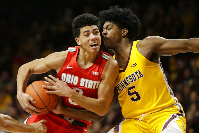 Minnesota guard Marcus Carr (5) plays defense against Ohio State guard D.J. Carton (3) in the second half during an NCAA college basketball game Sunday, Dec. 15, 2019, in Minneapolis. (AP Photo/Andy Clayton-King)